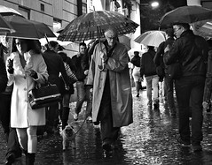 Yes it does rain in Rome. (Baz 120) Tags: life street city portrait people urban blackandwhite bw italy rome roma monochrome mono italia faces candid strangers streetphotography streetportrait olympus monotone streetphoto 45mm omd decisivemoment candidportrait streetphotographer m43 streetcandid mft streetphotograph primelens em5 candidstreet nightstreetphotography candidface grittystreetphotography