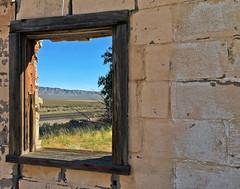 Desert View (Maureen Bond) Tags: ca maureenbond desert view mountains fence highway wood framed brick abandoned grass tree bluesky