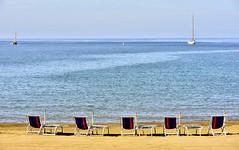 enjoying the last sun ... (miriam ulivi) Tags: miriamulivi nikond7200 italia liguria sestrilevante ottobre spiaggia beach beachchairs mare sea sailboat barcaavela sedieasdraio
