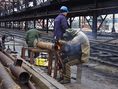 Pipe processing-2 (algimantas_tirlikas) Tags: building chimney construction crane montage mounter pipeline pipes rafinery workman work outdoor