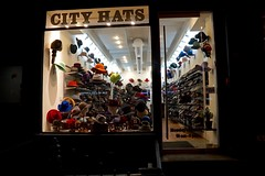 City Hats (spinadelic) Tags: stevespencer november 2016 fall autumn newyork ny nyc thecity urban gotham city hats downtown manhattan retail store shop caps headwear toppers night nighttime
