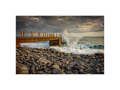 A splash of sunset... (silver/halide) Tags: madeira atlantic atlanticocean riesmagos pier rocks seashore seascape boulders sunset sunlight waves splash johnbaker d750