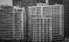 High-Rise Apartments (blake.thornberry) Tags: china bw white black building canon buildings high apartments apartment dalian 100mm highrise f2 prc  rise