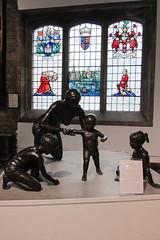 First Steps (Jocey K) Tags: uk england sculpture london church bronze artwork shadows unitedkingdom firststeps crests stainglasswindows allhallowsbythetower hoildayeurope2012