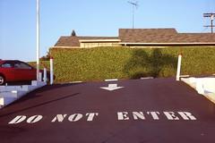 Do not enter (ADMurr) Tags: tlr film home rollei la stencil fuji parking slide chrome crop arrow shrub planar