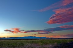 Sky On Fire (Tom Herlyck) Tags: blue light sunset red sky mountains beautiful grass clouds amazing colorado exposure awesome bigsky pikespeak skyonfire pueblocolorado southeastcolorado stembeach limecolorado