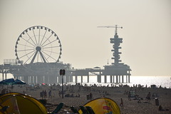 Our memory is a more perfect world than the universe: it gives back life to those who no longer exist. (Pics4life.nl off and on next week) Tags: beach sea silhouettes people colors colorful strand mensen silhouetten memory herinnering nederland scheveningen wheel reuzenrad fog heat