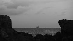 Mar(c) (lluiscn) Tags: sea mar aigua veler vaixell barco ship mediterrani mediterrnia mediterraneo roques cel nvol nublado veles pregonda cala platja menorca illes balears bn bw monochrome