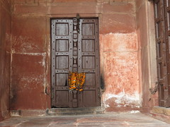 2016-11-04 Taj Majal - the door on the side of the mosque with a Hindur religious token probably left from the Diwali celebrations (Travel With Olga) Tags: tajmahal india agra mosque islam religion tomb mausoleum crypt mughal mogul mongol architecture monument cenotaph marble smog pollution monkey pools islamicart sandstone shahjahan mumtaz love lovers