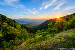 Sunrise Over Lovers Leap (scottymanphoto) Tags: appalachiantrail cliffwalk landscape loversleap spring summer virginia america bluesky blueridgemountains cliff closeup clouds colorful country edge flares gorge grass greenery highup hiking horizon luring meadowsofdan morning mountain mountains nature orangecoloredsky outdoors outside overlook peaceful ridge road scenery scenic shadows sky starburst sun sunflares sunlight sunny sunrise tranquility tree trees uphill usa valley wideview