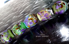 Rocks Green Splendor (Laura Blanck Openstudio) Tags: openstudio openstudiobeads glass handmade murano lampwork torched beads bead set big artist art arts fine artisan made usa rocks pebbles stones frit whimsical funky odd earthy organic abstract colrful multicolor lilac grape lavender purple violet jewelry published show winner festival italian argentinian shiny green ocher copper amber rare unique porcelain turquoise blue aqua mermaid mahogany