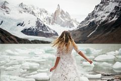 Laguna Torre (Lichon photography) Tags: travel lichonphotography argentina patagonia blondhair spin spinng ice burg mountain lake snow lagunatorre el chalten female girl woman dress beauty wow winter nature empower love longhair lookingforward back surreal adventure atmosphere