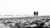 Verso l'infinito (F@bio F.) Tags: bianco nero monocromatico monocromo persone spiaggia mare passeggiata sabbia ombre luci walking black white monochrome sea beach sky people streetphotography lights shadow landscape high highkey silhouette