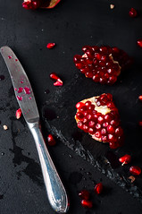 Pomegranates and pomegranate seeds on a dark background (lyule4ik) Tags: pomegranate health food vegetarian seed knife background dish diet organic eat healthy vitamin cut juice fruit fresh market tropics vegan tropical essential seasonal lime orange recipes perfume christmas supermarket evergreen cooking half garnet wooden red grocery harvest part wood ripe nutrition natural raw broken mojito section purple cocktails