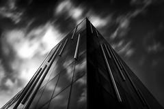 Glass Monolith (ISP Bruno Laplante) Tags: building skyscraper clouds glass tower dark long exposure monolith b w black white
