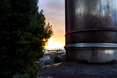 Hidden sunset. (Giuseppe Chirico) Tags: photo photography streetphotography sun sunset sunlight skylights skyline sky sunrise clouds redsky horizon smoke fire nature detail details color colors colorsinourworld colours shadow light shadows lights tree trees composition material roof roofview