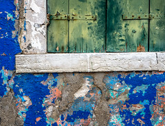 Flaking Paint (derek.dpr) Tags: burano venice venise venezia paint flaking shutter shutters blue green cill sill window architecture architectural decorative detail decoration decay decaying olympus omd em10