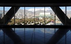 Tehran skyline against modern silhouettes (Germn Vogel) Tags: sky urban reflection tower window skyline modern iran middleeast inside tehran milad lookingout islamicrepublic