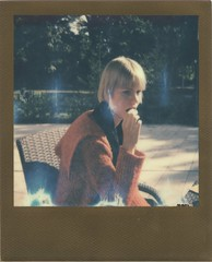 Rebeka with cookies --- RoidWeek, 2016 Fall, Day 5. no.1. (lengvari) Tags: polaroid impulse af | lucky8 color film impossibleproject girl fashion reddress goldframe redframe