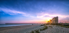 Sunburst At The Beach (Stuart Schaefer Photography) Tags: sunburst shoreline bluehour cloudscape sunset landscape condos clouds navarrebeach outdoors outdoor seascape evening pier florida sky cloud seaside coast shore