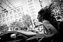 _DSC4535 (stimpsonjake) Tags: nikoncoolpixa 185mm streetphotography bucharest romania city candid blackandwhite bw monochrome running man hair longhair catchingthebus