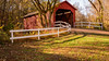Covered Bridge (Brian Schuessler) Tags: nikon tamron16300 nikond5500 bridge coveredbridge wood barn old covered fence whitefence fall autumn water red light park landscape rural country splitfence outdoor missouri historic building