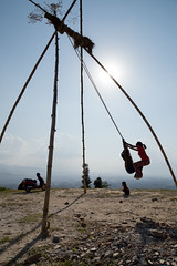 Children on bamboo swings over Kathmandu Valley