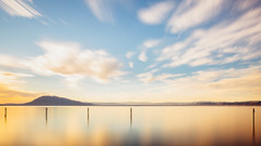 Far Away From It All (John Westrock) Tags: longexposure california lucerne lake water reflection sky clouds motion canoneos5dmarkiii canonef2470mmf28lusm bwnd1000x sunrise