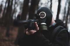 Apocalypse (Sean Sullivan Photography) Tags: dark creepy grunge apocalypse apocalyptic structures nature war trees forest gasmask gun model mae male alone lonely cloudy overcast light faded single backpack