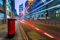 London Busses travel past a red Royal Mail Post box. In view the Heron Tower and St Mary Axe (Christine's Observations) Tags: london financial district light streams trails europe explore happiness travel speed commercial street spital fields shoreditch christinephillips