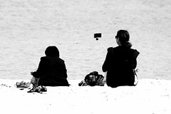 I can see you (Wackelaugen) Tags: ocean sea people blackandwhite bw woman white black beach water canon person photography eos mono photo blackwhite spain women mallorca selfie googlies sacoma illot wackelaugen selfiestick