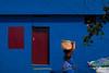Blue. Kanyakumari, India (Marji Lang Photography) Tags: life street door travel blue light people woman india house color building colors wall composition walking photography daylight colorful geometry walk painted indian streetphotography documentary going bleu colourful tamil tamilnadu carrying kanyakumari inde southindia bluehouse streetshot travelphotography indianpeople 2013 indiansubcontinent streetcomposition kaniyakumari colorfulsetting marjilang