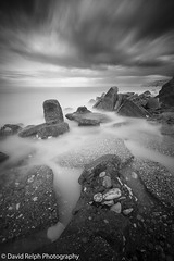 Milky Waters (David Relph) Tags: longexposure sea blackandwhite bw seascape motion beach clouds canon mono coast movement rocks yorkshire wideangle northyorkshire longshutterspeed movingclouds weldingglass reighton tamron1024mm davidrelph davidrelphphotography