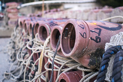 Octopus traps, Ohamacho (Eric Flexyourhead) Tags: ohama ohamacho toba tobashi  mieken  kansai  japan  port harbour fishingport trap octopus tako repetition shallowdepthoffield bokeh olympusem5 olympusmzuikodigital17mmf18 17mm zd