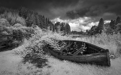 Retired (GJ Duncan Photography) Tags: scotland lochard mono retired blackandwhite moody atmospheric infrared ir infraredphotography nikon d90 landscape boat old clouds nature