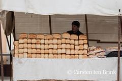 Khiva market - behind the bread (10b travelling) Tags: 10btravelling 2015 asia asien carstentenbrink centralasia dishonqala genericplaces iptcbasic ichonqala khiva otherkeywords polvondarvoza silkroad sovietunion ussr uzbek uzbekistan xiva bread east gate loaf market tenbrink thestans