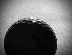 Natural Light On A Golf Ball (igd65) Tags: macromondays backlit golfball monocrome blackandwhite 7dwf