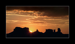 Monument Valley sunrise (tkimages2011) Tags: monumentvalley monument valley sun sunrise yellow orange sky clouds nationalpark buttes navajo reservation landscape rocks golden utah mitten