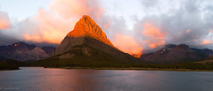 Grinnell Point on Fire (1ns0mn1ac) Tags: shadow manyglacierhotel cloudy water labcolorspace glaciernationalpark photoshop lake red morning manyglacier warm sky swiftcurrentlake balcony panorama rockiestrip grinnelpoint sunlight mountwilbur mountgrinnell lightroom mountain