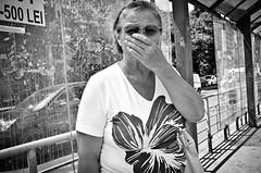 _DSC4886-2 (stimpsonjake) Tags: nikoncoolpixa 185mm streetphotography bucharest romania city candid blackandwhite bw monochrome oldwoman yawn sunglasses hand