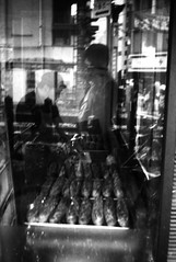 (generation) (Dinasty_Oomae) Tags: lomo  smena8m 8m  blackandwhite bw monochrome outdoor   tokyo street  setagaya  shoinshrineavenue   festival bakery   reflection
