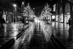 2016_321 (explored) (Chilanga Cement) Tags: fuji fujix100t fujixt1 x100t xseries x100s x100 bw blackandwhite preston fishergate lights water rain perspective shoppers trees road pavement sidewalk roadside car middleoftheroad distance headlights winter brilliant wow