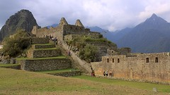 Machu Picchu (oxfordblues84) Tags: peru unesco unescoworldheritagesite cusco cuscoprovence machupicchu andes andesmountains oat overseasadventuretravel inca incaruins lostcityoftheincas bucketlistdestination stonestairs staircase stonestaircase travelers people tourists sky clouds cloudysky mountain andesmountainchain grass green architecture building