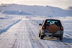 SUV car on the empty road in Iceland (Istockr) Tags: blizzard cold conditions country driving empty free godafos godafoss green highway hills holiday horizon iceland icelandic landscape lane lifestyle lights looking lost mountain mountains natural nature night nobody northern nowhere path road sky snow snowfall snowing snowstorm space stars storm success tiremarks tiretracks tracks travel vacation weather white winter