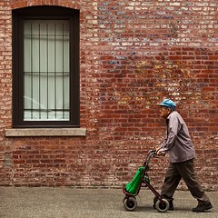 Walking by (gordeau) Tags: people wall bricks window walking candid gordon ashby gordeau square unanimous