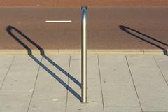 Cycle rack and shadow (Jan van der Wolf) Tags: map15765v nietje cyclerack shadow schaduw fietspad shadows shadowplay composition compositie