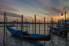 Gondola Sunset, Venice (Marie-Louise Garratt) Tags: trip travel venice sunset sky italy sun holiday colour water silhouette night clouds river photography boat photo europe flag gondola