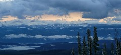 The clouds clear (Eddie the Explorer) Tags: canada bc britishcolumbia mountains sunset bigwhite clouds trees snow winter