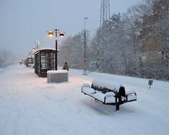 Farsta Strand (J) (Mister.Marken) Tags: cold yellow white snowing outdoor lamp bench sweden farststrand winter snow trainstation järnvägsstation nikon nikond5100 nikonnikkor station platform clock