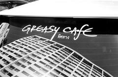 Greasy Cafe (35mm) (jcbkk1956) Tags: greasy cafe car sign window glass reflection building film 35mm analog yashica rangefinder ministerd ilfordpan100 ilford yashinon bangkok thailand worldtrekker contrast